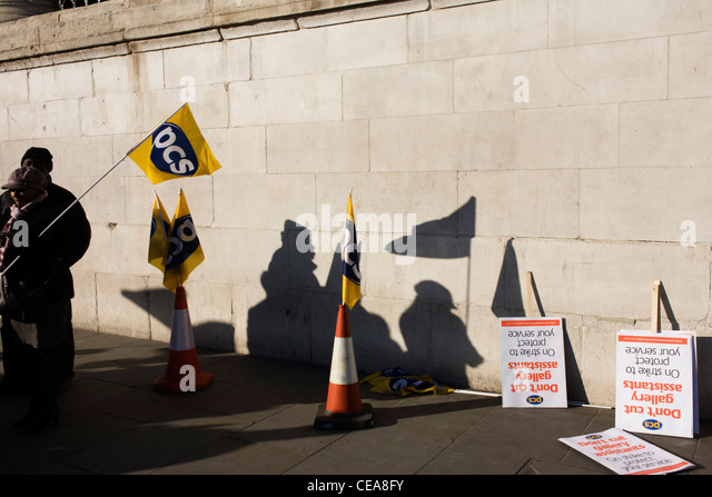 Staff silhouetted from the Public and Commercial Services Union PCS union outside National Gallery, London - Stock Image