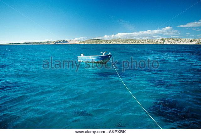 Rowboat at coral bay - Stock Image