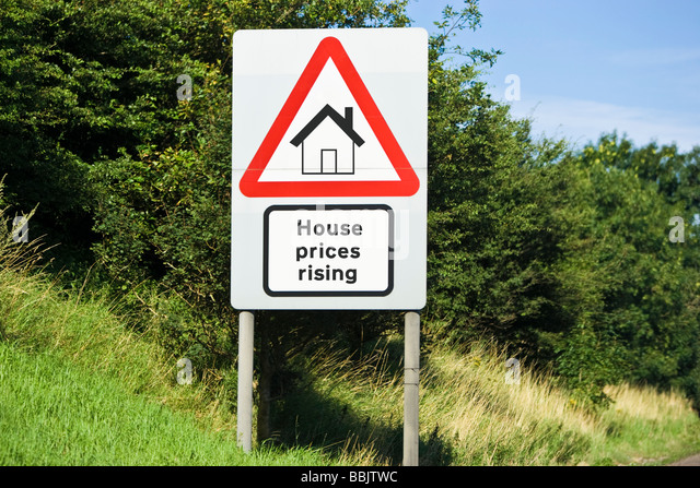 Concept sign showing House prices rising, England UK - Stock Image