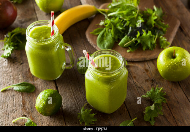 Healthy Organic Green Fruit Smoothie with Spinach and Apples - Stock Image