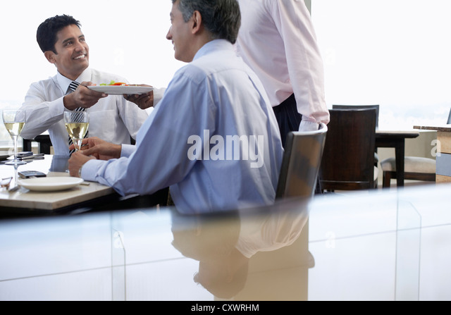 Business people having lunch together - Stock-Bilder