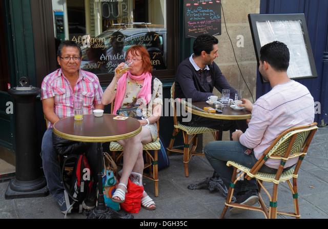 Paris France Europe French 8th arrondissement Rue de l'Isly restaurant cafe bistro brasserie bar Hispanic man - Stock Image