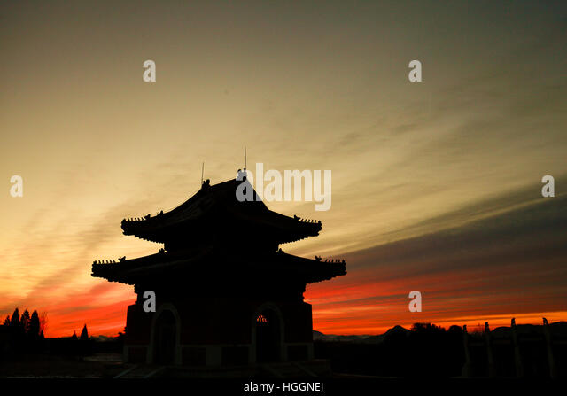 Zunhua. 10th Jan, 2017. Photo taken on Jan. 10, 2017 shows an ancient building against the morning glow in the Dongling - Stock Image