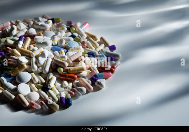 Close up of pile of assorted pills - Stock Image