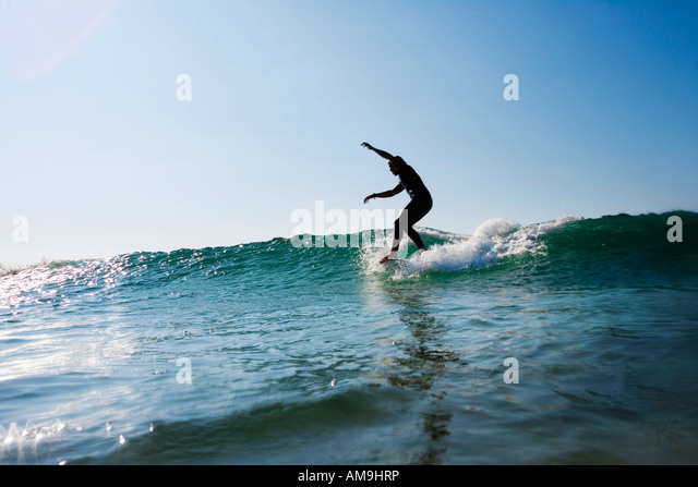 Man surfing a wave. - Stock Image