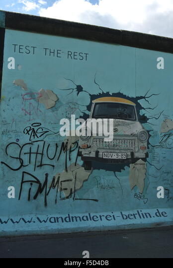 Graffiti, Car smashing through wall, Berlin Wall - Stock Image