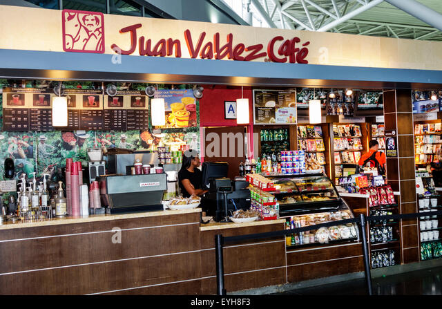 New York Queens John F. Kennedy International Airport JFK inside interior terminal concourse gate area Juan Valdez - Stock Image