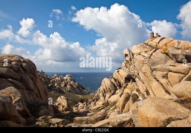 Rock formations on coastline - Stock Image