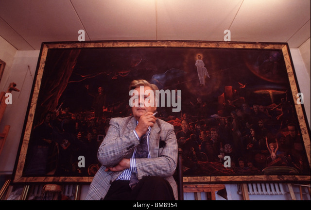 Russian Artist, Ilya Glazunov, sitting in front of his original Controversial painting 'Mystery of the Twentieth - Stock Image