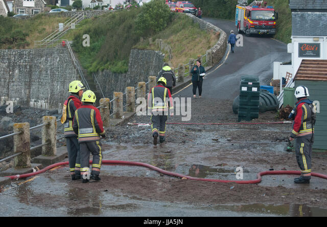 Coverack, Cornwall. 18th July 2017.   Cornwall Fire and Rescue in Coverack after Flash flood in coastal village - Stock Image