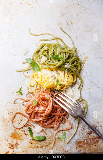 Italian pasta Italian flag colors with basil and parmesan - Stock Image
