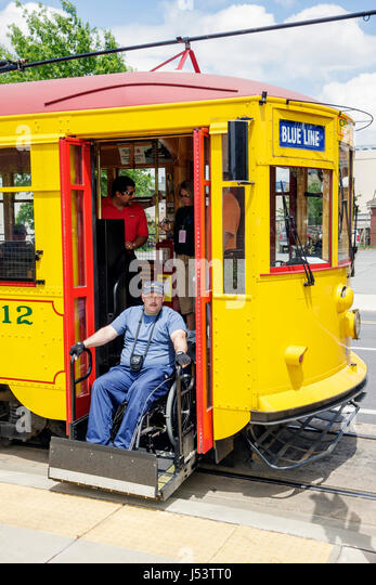 Arkansas North Little Rock North Maple Street River Rail Electric Streetcar man disabled wheelchair accessible ramp - Stock Image