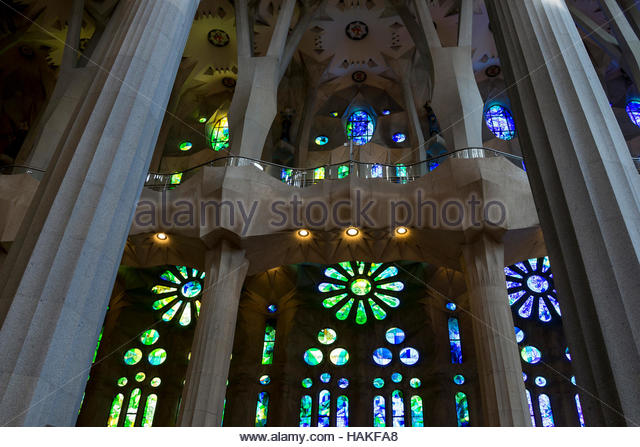 Interior of La Sagrada Familia with Stained Glass Windows in Barcelona, Spain - Stock Image
