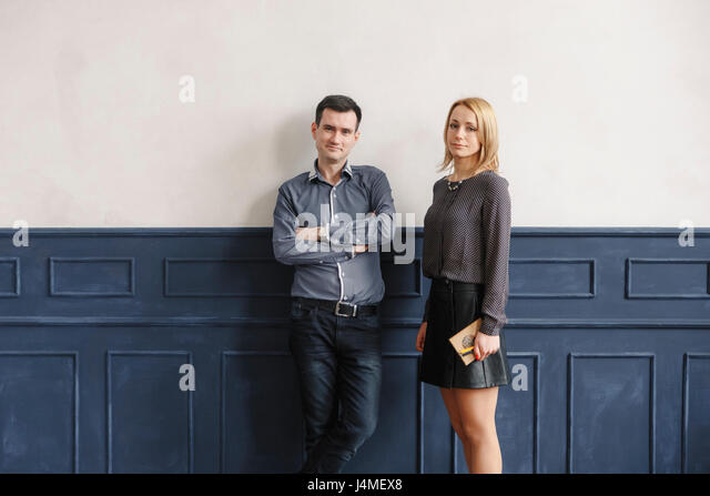 Portrait of Middle Eastern couple standing near wall - Stock-Bilder