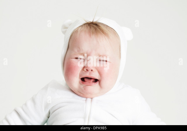 Baby girl crying - Stock Image