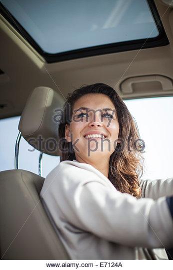 Woman at wheel of car - Stock Image