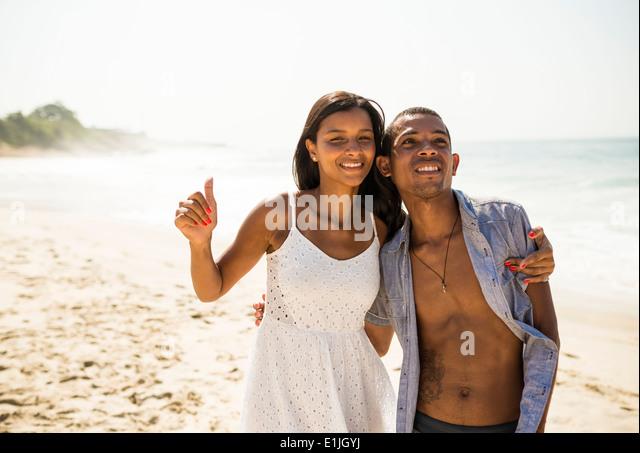 Young couple on Arpoador beach, Rio De Janeiro, Brazil - Stock Image