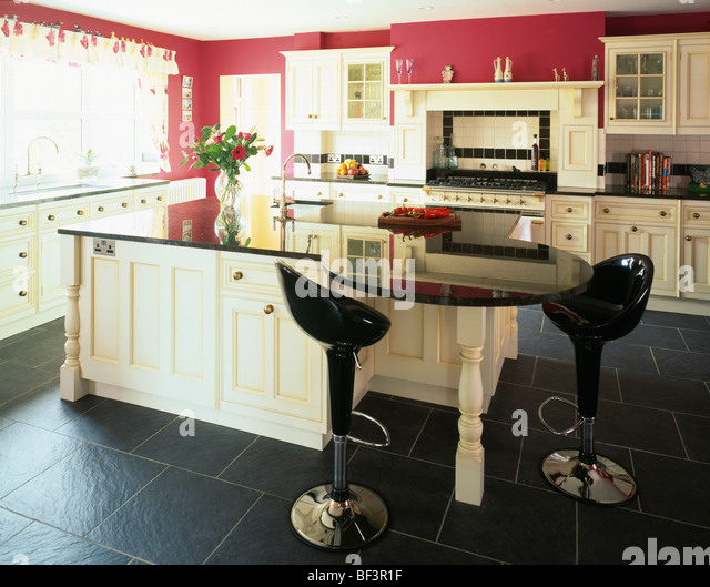 Black worktops stock photos black worktops stock images for Red fitted kitchen