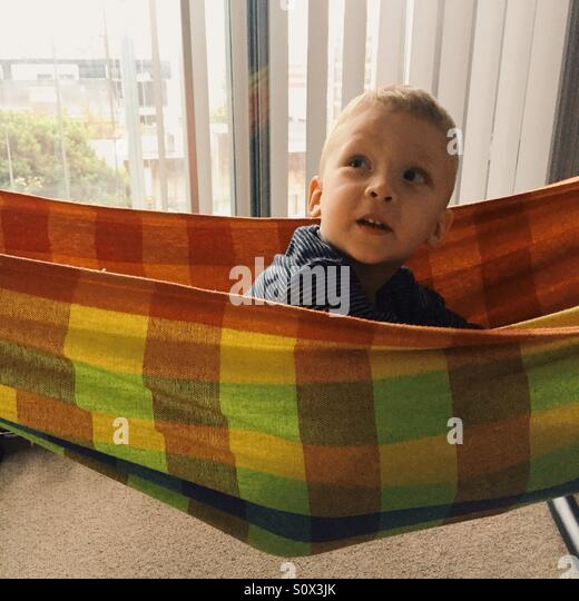 Little boy in hammock - Stock Image