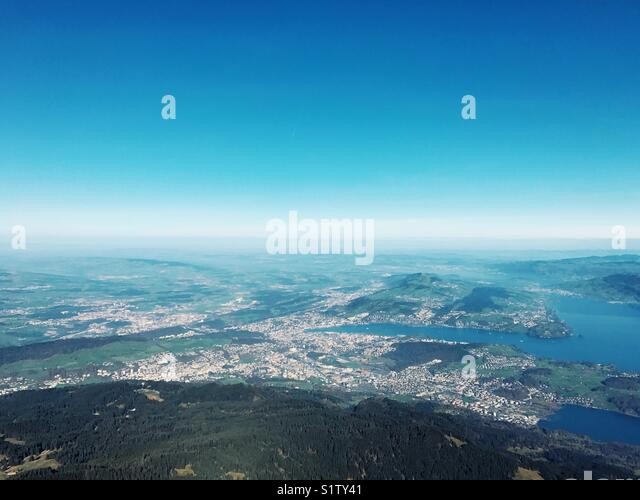 Aerial view of mountain, trees, lake and sky in Switzerland - Stock Image