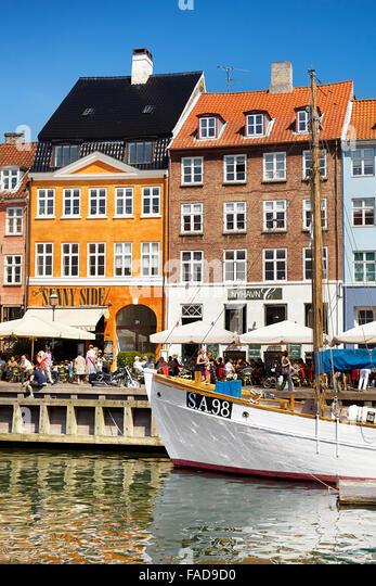 The boat in Nyhavn harbour, Copenhagen, Denmark - Stock Image