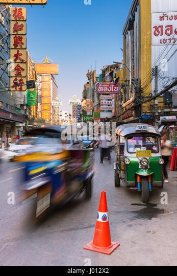 Bangkok, Thailand - April 24, 2016: Tuk-tuk taxi parked near street market in Chinatown on April 24, 2016 in Bangkok, - Stock Image