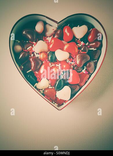 Valentine box with heart candies - Stock Image