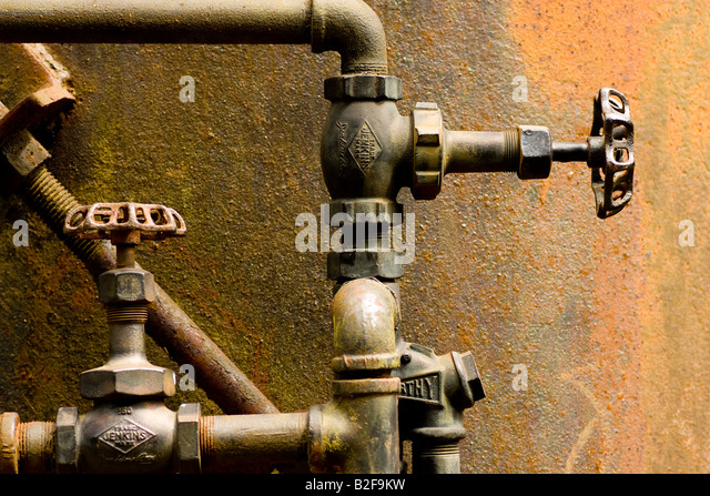 Antique drain stock photos antique drain stock images for What are old plumbing pipes made of