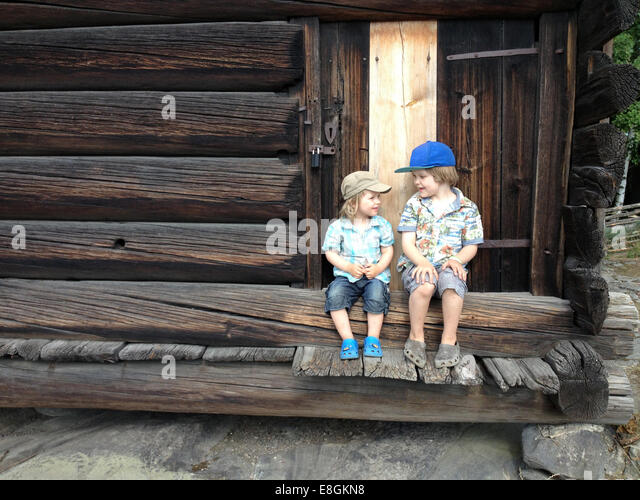 Stockholm, Sweden 2 Brothers, Young Boys Sitting On The Porch - Stock Image