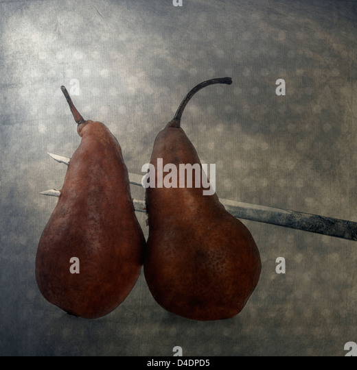 two pears, pierced on a big fork - Stock Image