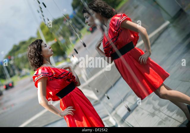 Woman in soaking wet dress adjust her outlook - Stock Image