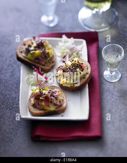 Leeks,seeds and smoked gammon on toast - Stock Image