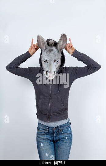 Woman wearing a donkey mask and miming hip hop culture She is wearing a hoody and a jeans with holes - Stock Image