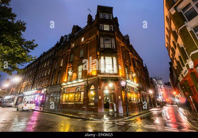 Duke of Argyll Pub in Soho, Dusk , Rainy Day, City of London, United Kingdom - Stock Image