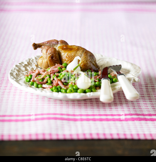 Pigeon with peas - Stock Image