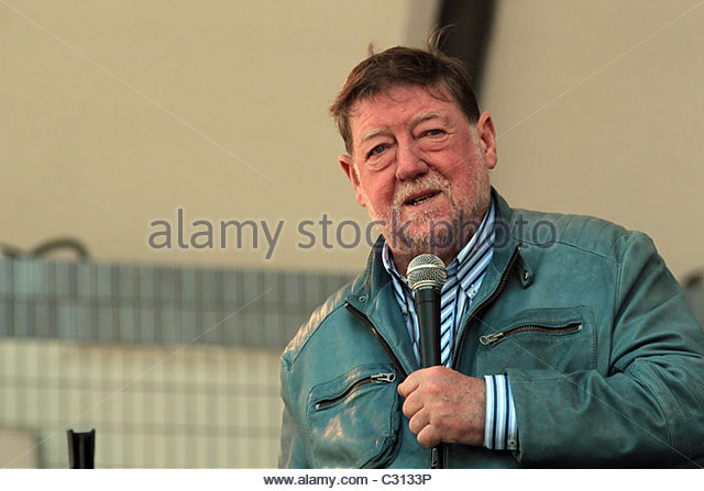 C.W Nicol MBE addresses a crowd of people gathered for the 'Energy Shift Now' parade in Tokyo, April 24, - Stock Image