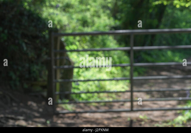 Soft-focus abstract metal gate - metaphor for the countryside and country activities. - Stock Image