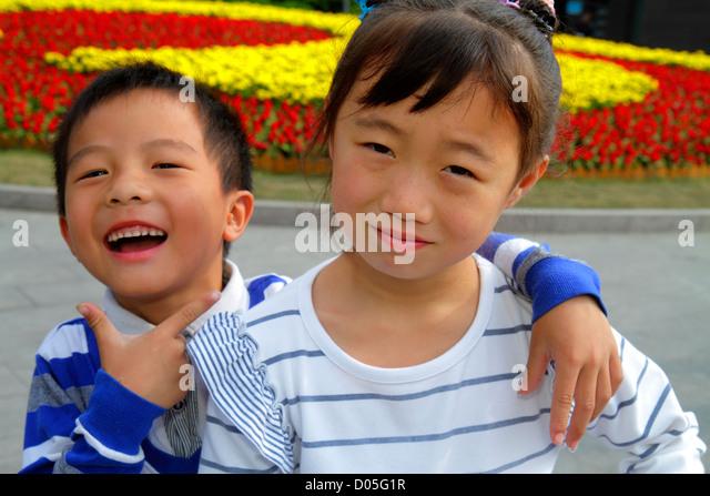Shanghai China Huangpu District The Bund Zhongshan Road National Day Golden Week Asian girl sister boy brother siblings - Stock Image