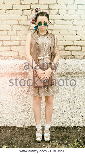 portrait of young active girl of the hipster outdoors in sunglasses - Stock Image