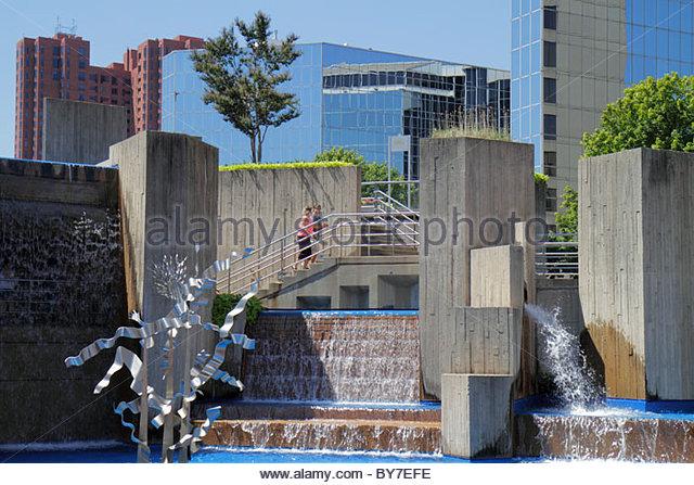 Maryland Baltimore Inner Harbor General Sam Smith Park McKeldin Fountain metal sculpture public art urban park office - Stock Image