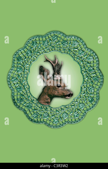 Deer collage artwork in picture frame against green background - Stock Image