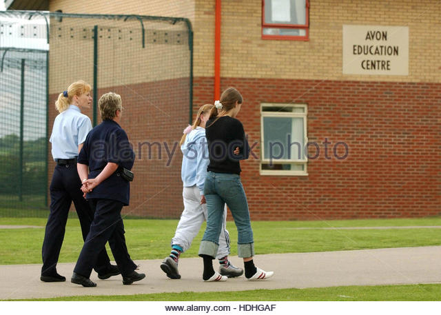 File photo dated 2/6/2003 of young offenders escorted by staff at Rainsbrook Secure Training Centre, Willoughby. - Stock Image