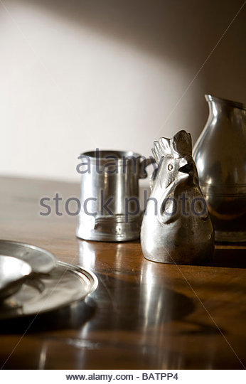 Metal Rooster Shaped Pitcher - Stock Image