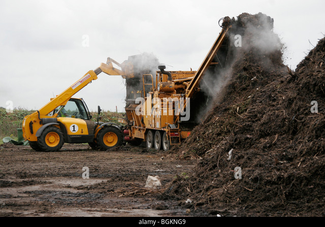 Recycling Garden Waste Into Compost To Be Used On Farm Land - Stock Image