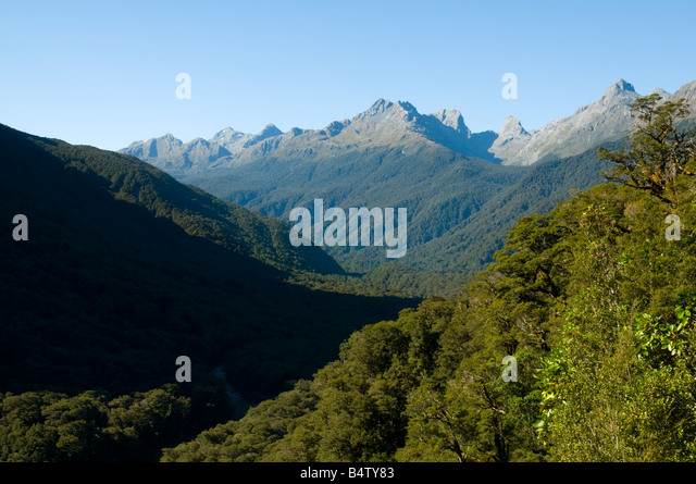 The peaks of the Humboldt Mountains over the Hollyford Valley, near Milford Sound, Fjordland, South Island, New - Stock Image