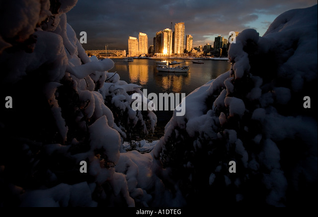 Sunrise over False Creek, Vancouver, British Columbia, Canada after days of record snow showers. November 28th 2006. - Stock Image
