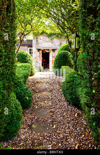 Garden Path Looking Back At The Door Of An English Stone Cottage Designed