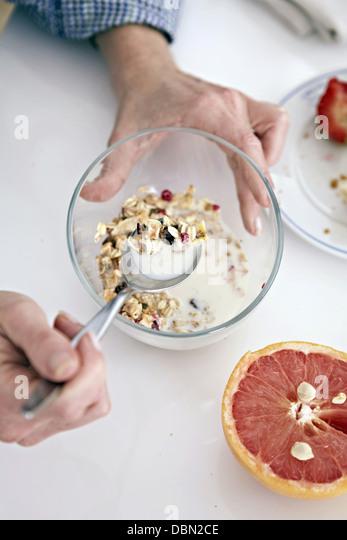 Person Eating Cereals - Stock-Bilder