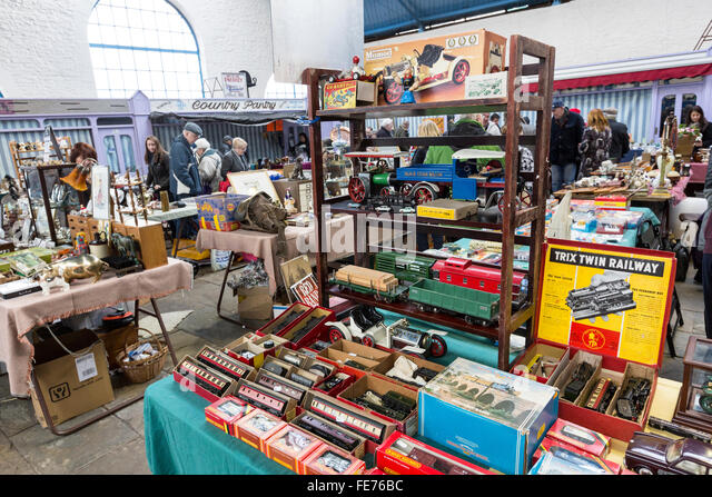 Indoor antique flea market with toy trains on sale, Abergavenny, Wales, UK - Stock Image