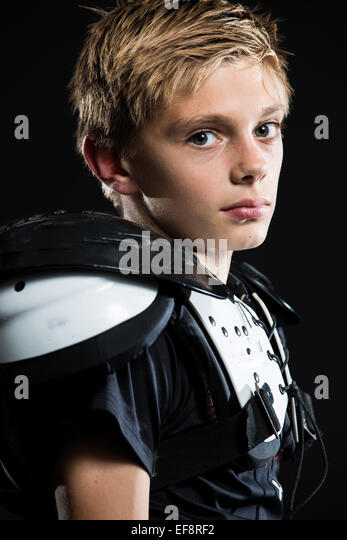Portrait of a boy wearing American football strip - Stock Image